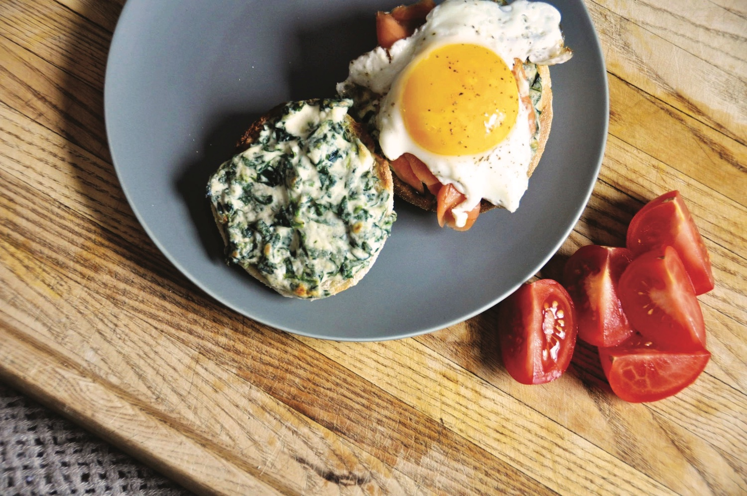 Kale and creamy spinach duo on english muffin