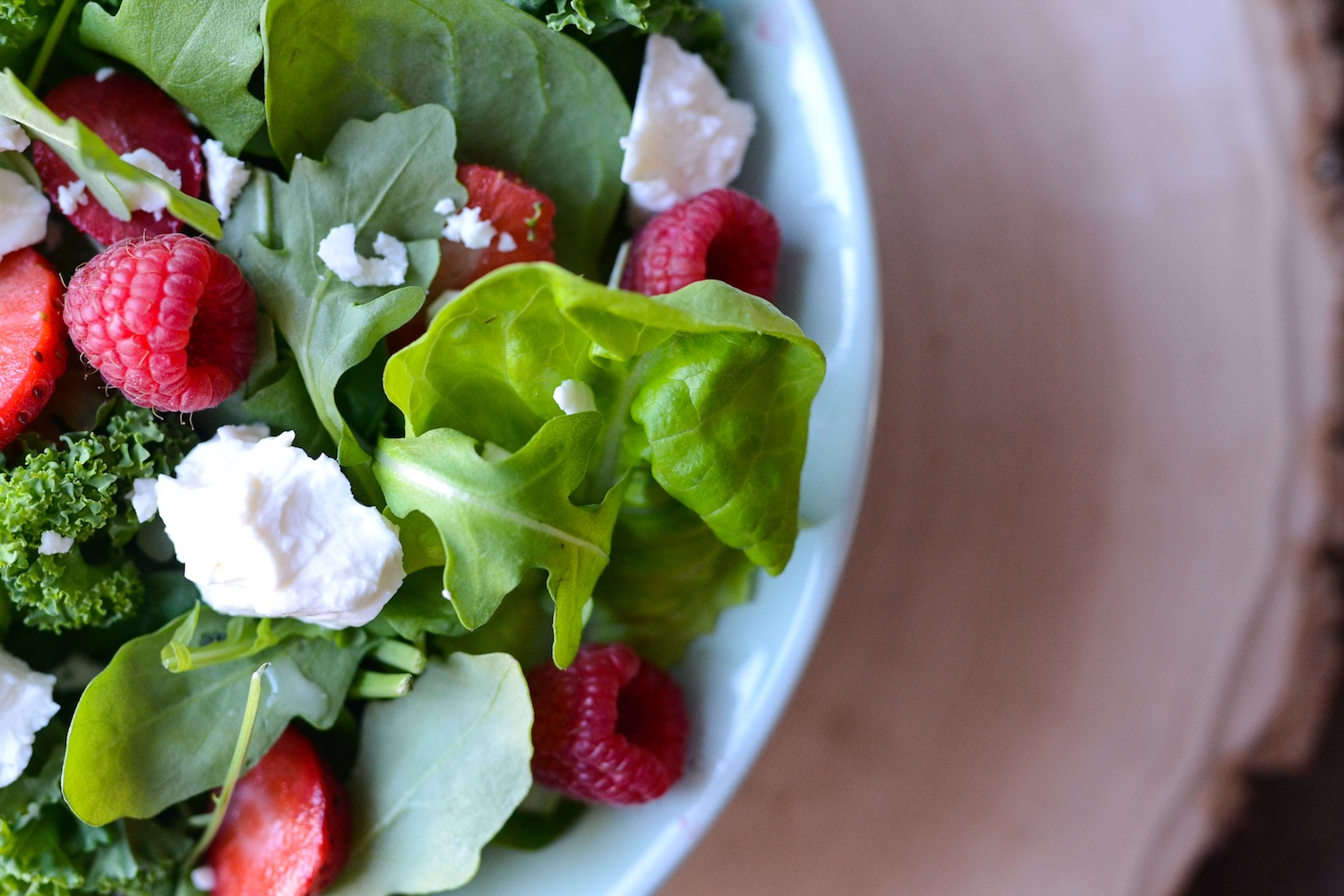 Spinach salad with kale with feta, strawberries and raspberries